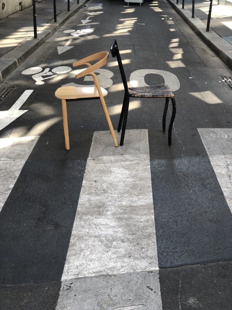 opposite chairs on the streets of paris