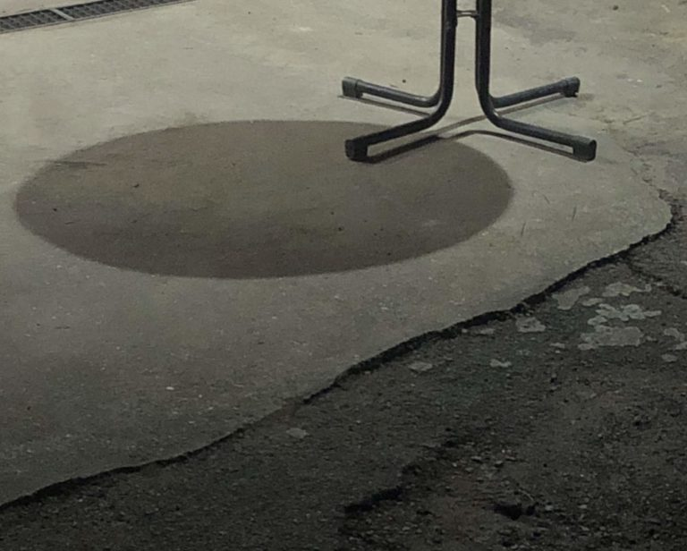 circle shadow from a table on the floor