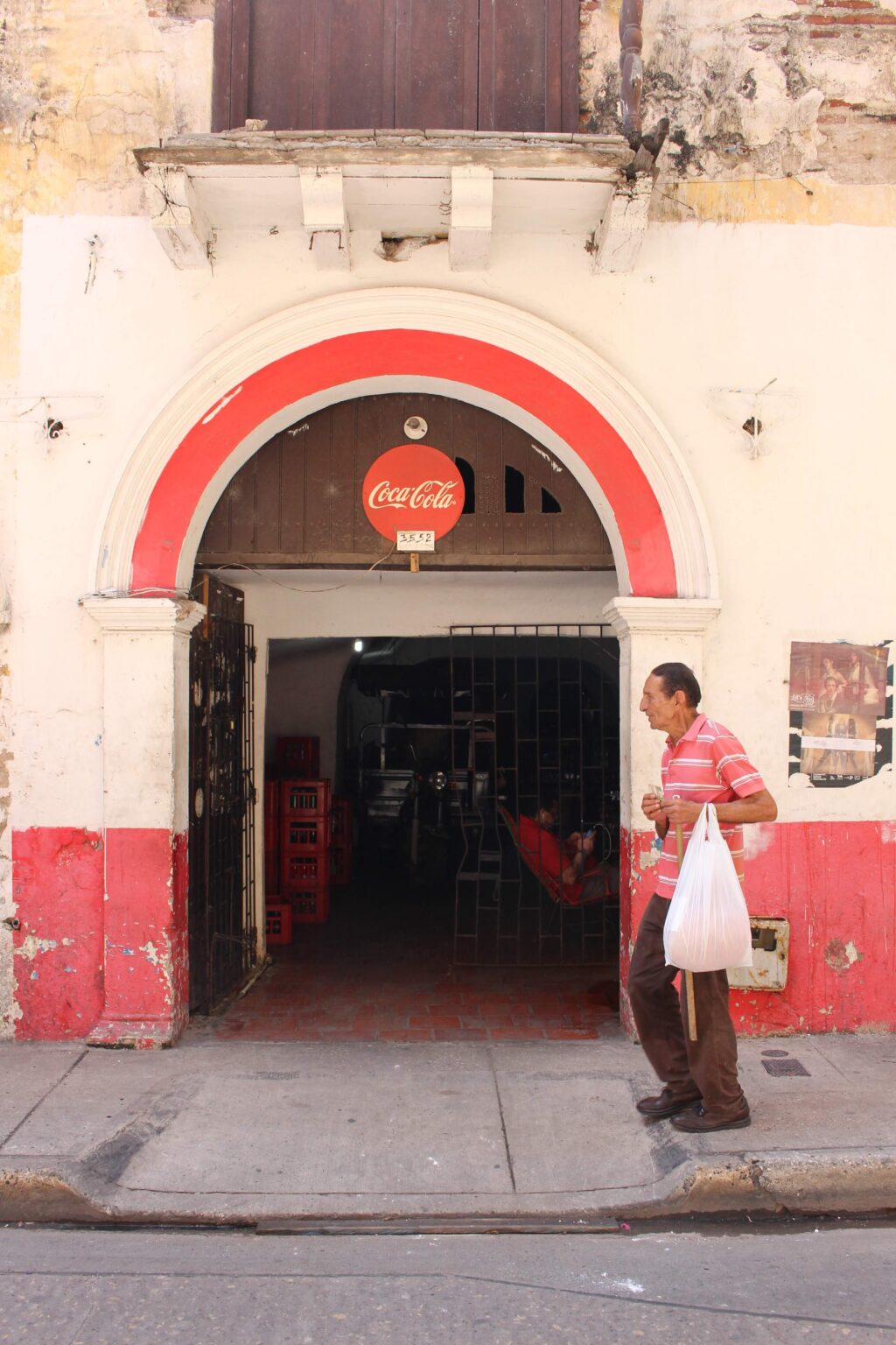 Man in front of Coca Cola in Cartagena, Colombia, 2016